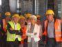 Gérard Collomb, Myriam Picot, David Kimelfeld, Anne Brugnera lors de la visite du chantier de rénovation de La Grande Halle à Gerland le 30 août 2016. © BE/Rue89Lyon