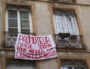 """Banderole sur la façade d'un immeuble rue Jangot, à l'initiative du collectif """"la Guillotière n'est pas à vendre"""". Lyon 7ème lundi 4 février 2019. ©MG/Rue89Lyon"""