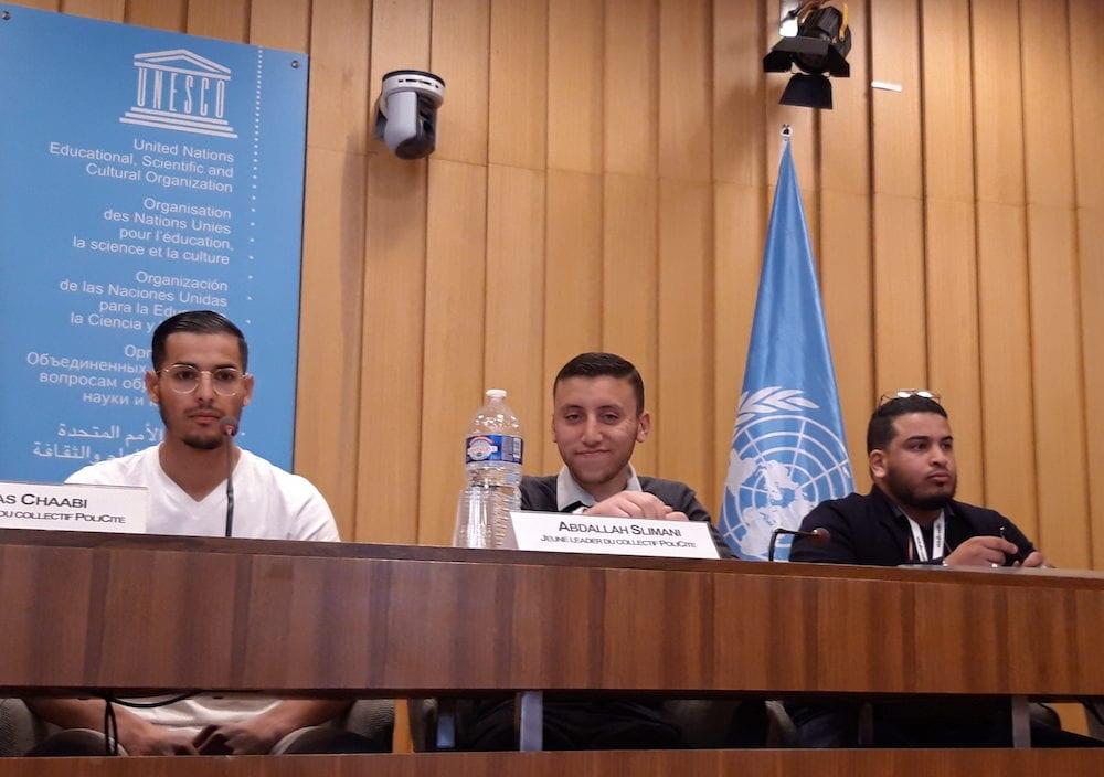 Trois jeunes Vaudais du collectif PoliCité, à la tribune de l'Unesco le 16 mai. De gauche à droite : Ilyas Chaabi, Naïm Naïli et Abdallah Slimani. ©LB/Rue89Lyon